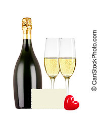 Two glasses of champagne, bottle, greeting card and red...