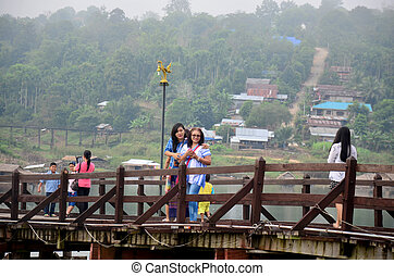 People travel and portrait on Saphan Mon wooden bridge in...