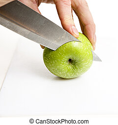 apple sliced - sliced green apple in multiple peices with...