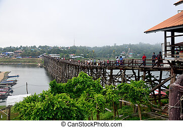 People travel and waiking on Saphan Mon wooden bridge in...