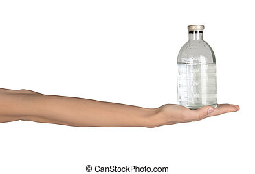 Close-up of female hand holding medical solution in a bottle