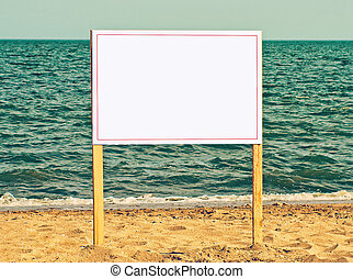Blank billboard on sandy beach.Just add your text.