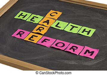 health care reform crossword - colorful sticky notes on a...