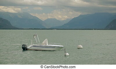 Lake Geneva. A boat is reeling on the water.