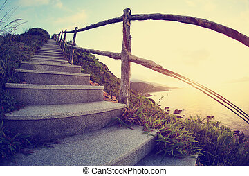 beautiful seaside mountain stairs lead to sky at sunrise