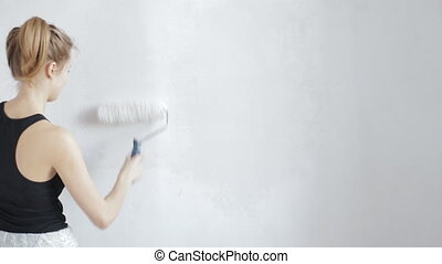 Painting wall in white color with paint roller