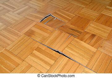 Ruined Wooden Floor - Ruined wooden floor in living room of...