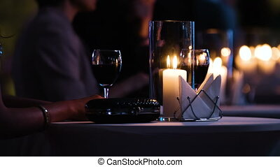 Close-up footage of elegantly decorated table at...