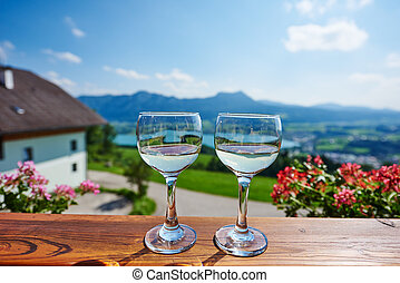 Two glasses of wine in austrian mountain outdoors - Two...