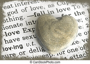 heart and text - stone heart on dictionary love text