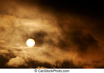 Dark storm clouds and setting sun - Image of the dark storm...