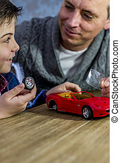 building model car together - father and son building a...