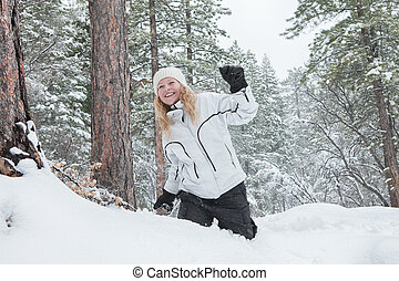 x-mas walk - Portrait of young beautiful woman on winter...