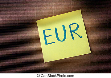 EUR text on yellow sticky note