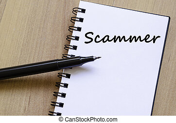 Scammer write on notebook - Scammer text concept write on...