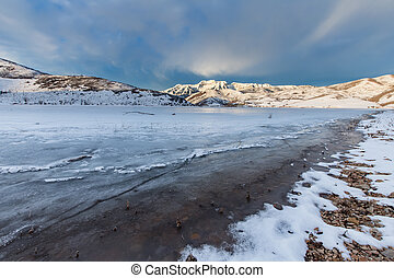Frozen Lake with mountains - Frozen Deer Creek Reservoir...
