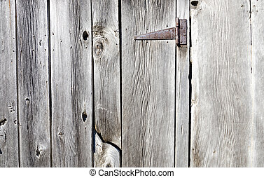 Rusty hinge on a barnboard door - A weathered and rusty...