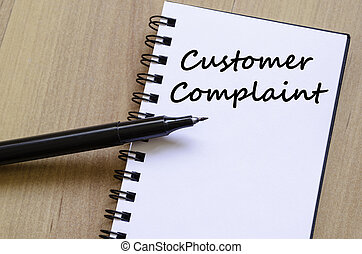 Customer complaint write on notebook - Customer complaint...