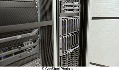 IT technician removes harddrive from blade server in...