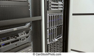 IT technician install harddrive in blade server in...
