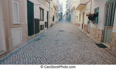 Walking on Old Narrow Street, Nazare Portugal