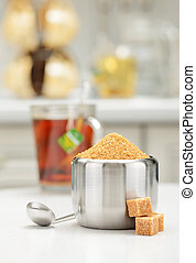 Steel sugar bowl - Steel sugar-bowl with pile of brown sugar...