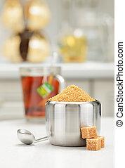 Steel sugar bowl - Steel sugar-bowl with pile of brown sugar...
