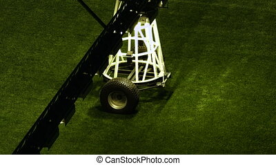 Close-up footage of one element of artificial light system for growing lawns at an empty stadium.