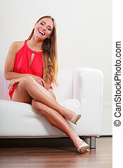 Cute fashion woman in red shirt on sofa couch - Portrait of...