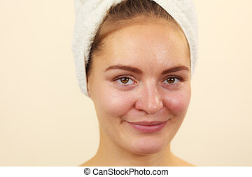 Woman in towel on head with no makeup