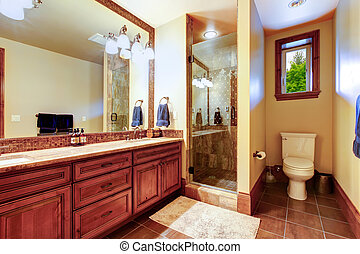 Elegant bathroom with warm colored interior.