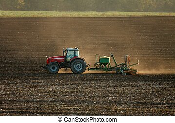 Agriculture - Tractor plowing the fields