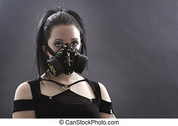 Goth girl with gas mask - head shot of a teenage girl with...