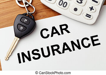 Car insurance with car key and calculator on wood table