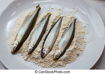 raw fish smelt in flour ready for frying