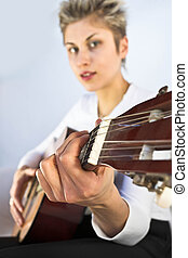 woman and guitar - Blond short hair woman woman with white...