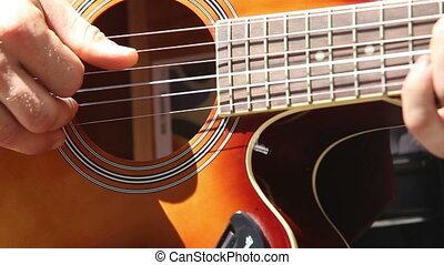 european man plays guitar closeup - european man plays...