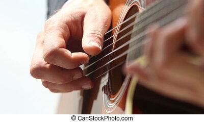 european man plays guitar closeup - european man plays...