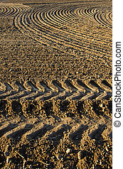 Newly plowed clay soil field
