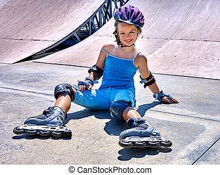 Girl riding on roller skates. - Girl wearing roller skates...