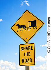 Amish road sign - A road sign warning drivers to share the...
