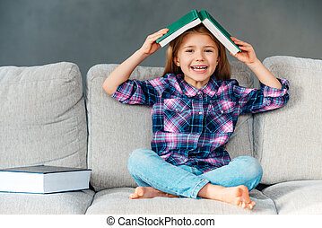 Knowledge assimilate better this way! Cheerful little girl...