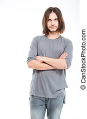 Attractive serious young man with long hair