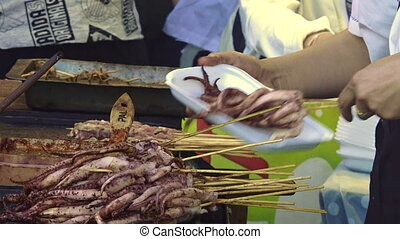 Grilled Squids in Chinese food market