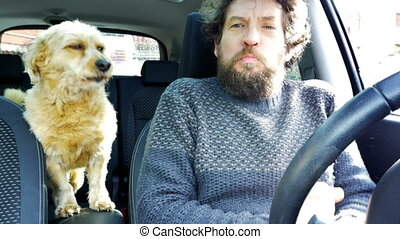 Man playing with dog in car both barking - Cute puppy...