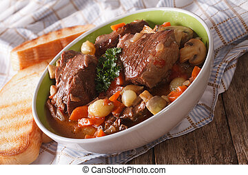 French cuisine: beef Bourguignon close up in a bowl....
