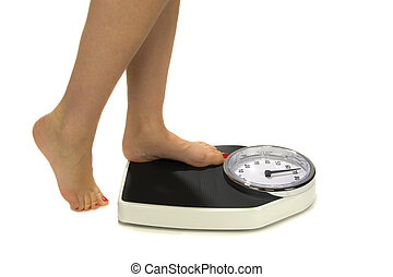 Weight Scale - A woman standing on a weight scale