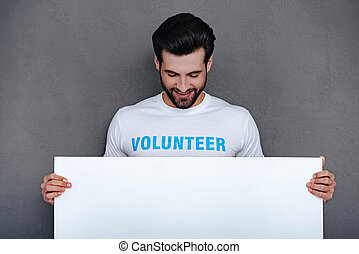 Please help to community! Confident young man in volunteer...