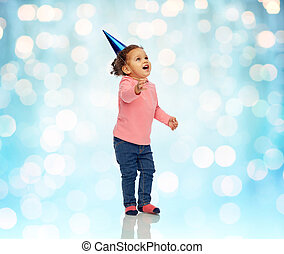 happy little baby girl with birthday party hat - childhood,...