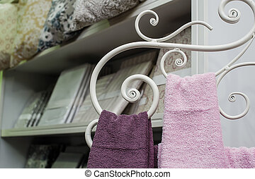 Two towels hanging on a metal rack